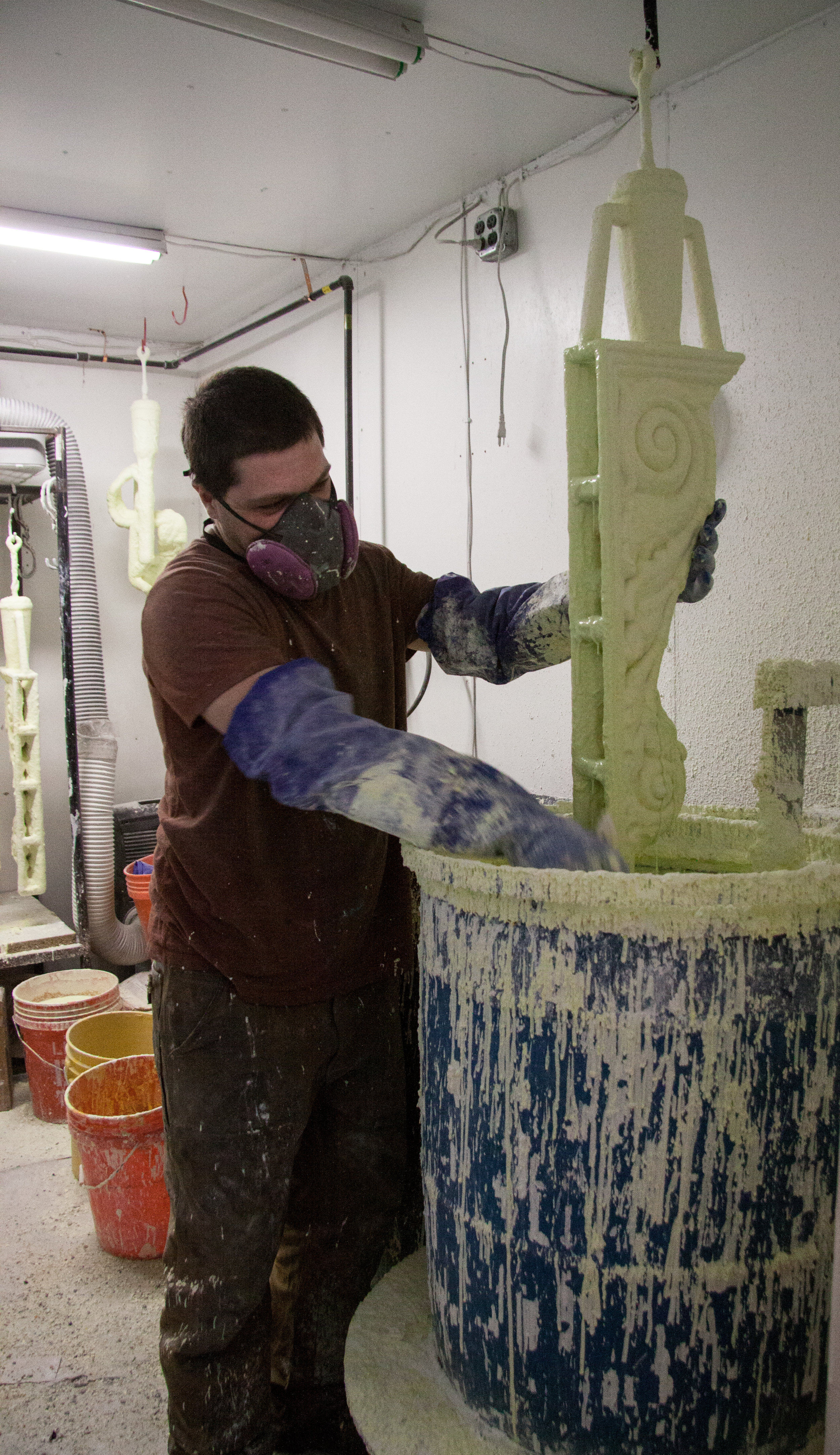 Dipping the wax to build up the ceramic mold.