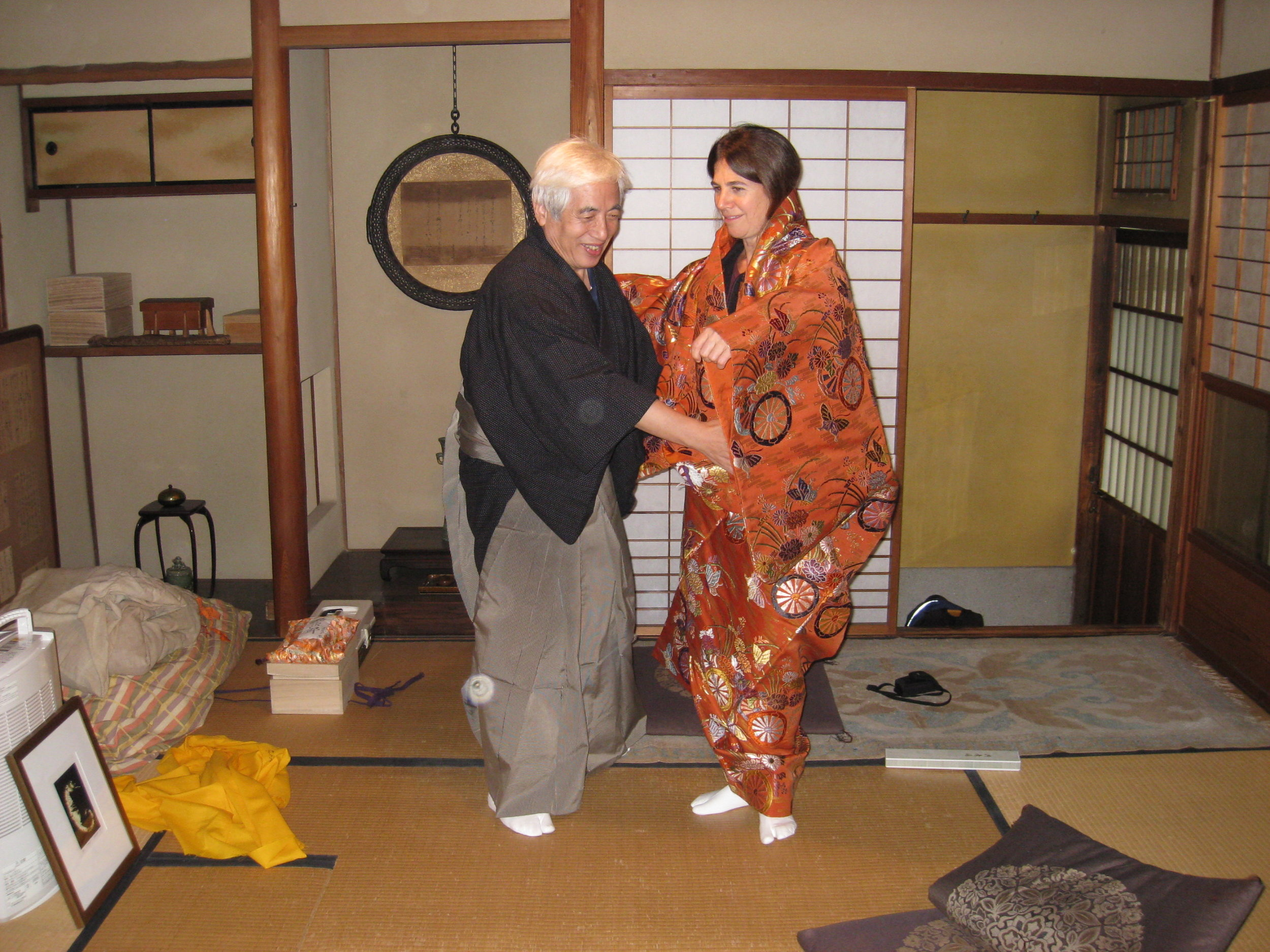 Trying on a silk kimono with my Noh teacher, Takabayashi Koji Sensei.