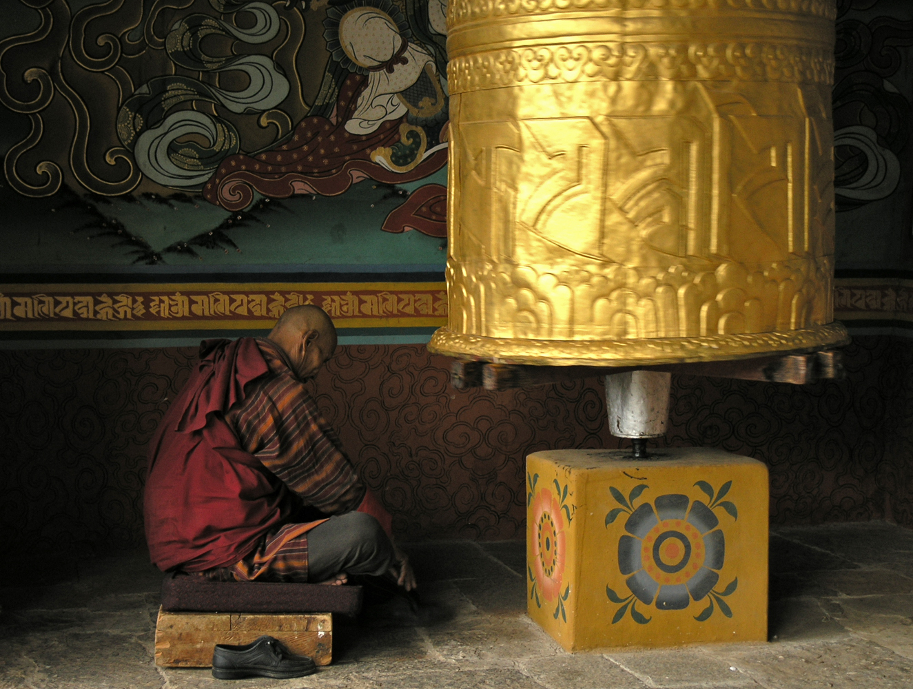 Turning a large Prayer Wheel, Bhutan     Photo:LH