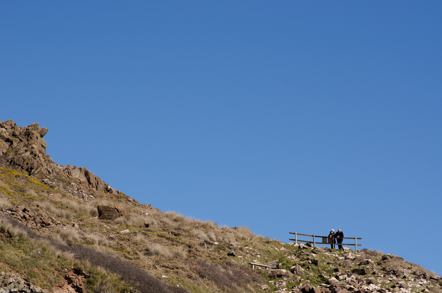 The couple on the cliff enjoying kynance cove