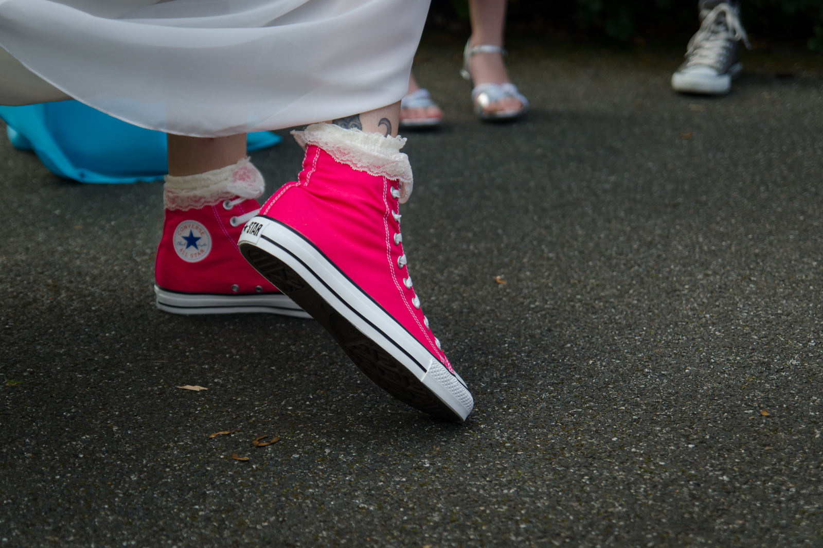 a pair of pink converse shoes for this alternative wedding