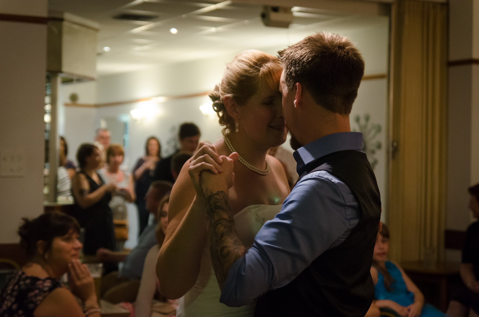 The tattooed groom and bride having their first dance