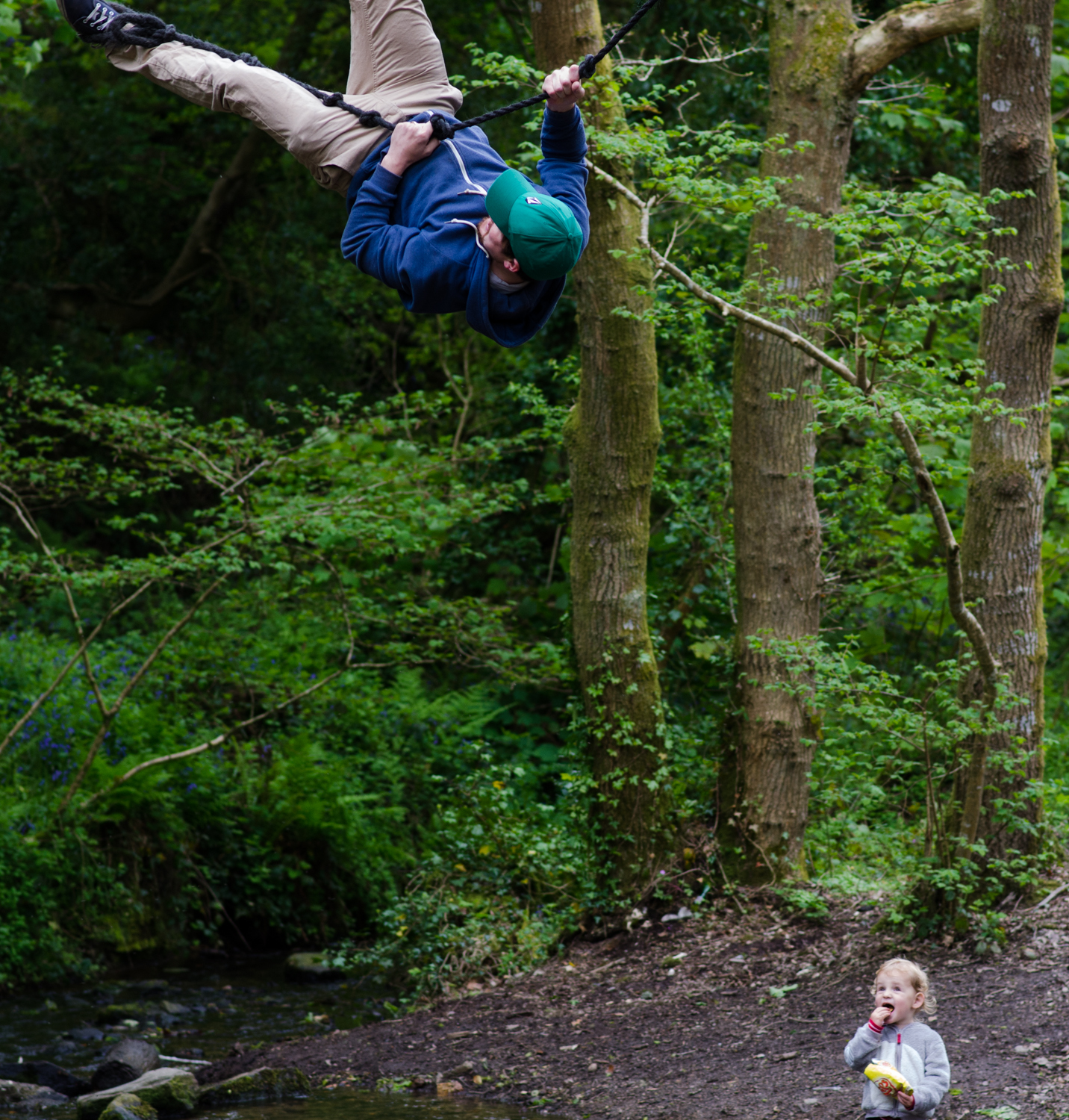 My son watching as I rope swing at lower town woods