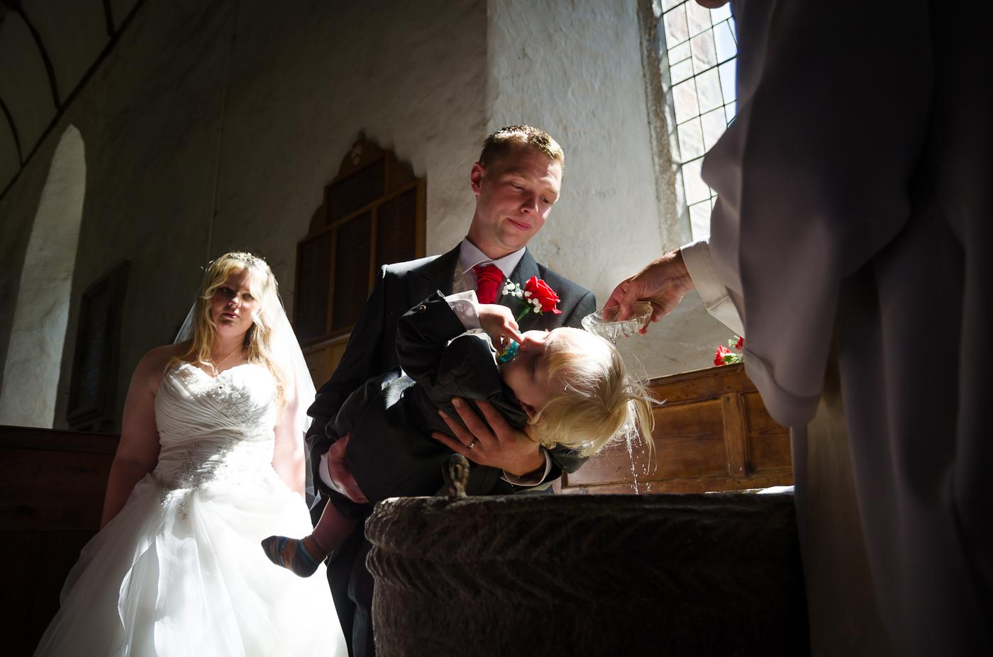 Rupert getting christened