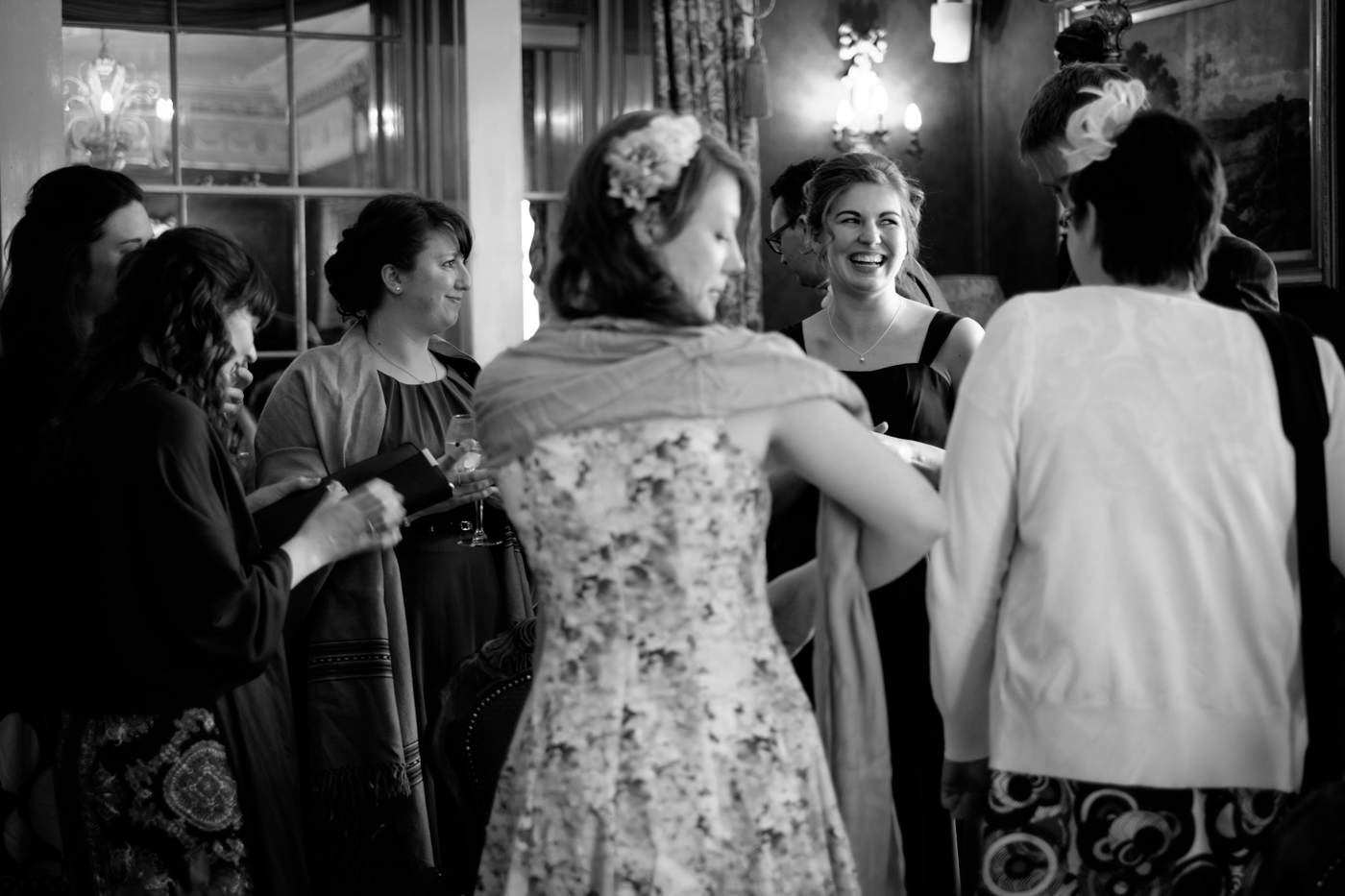 The bridesmaid and friends catching up before the ceremony, caught the smile love moments like these.