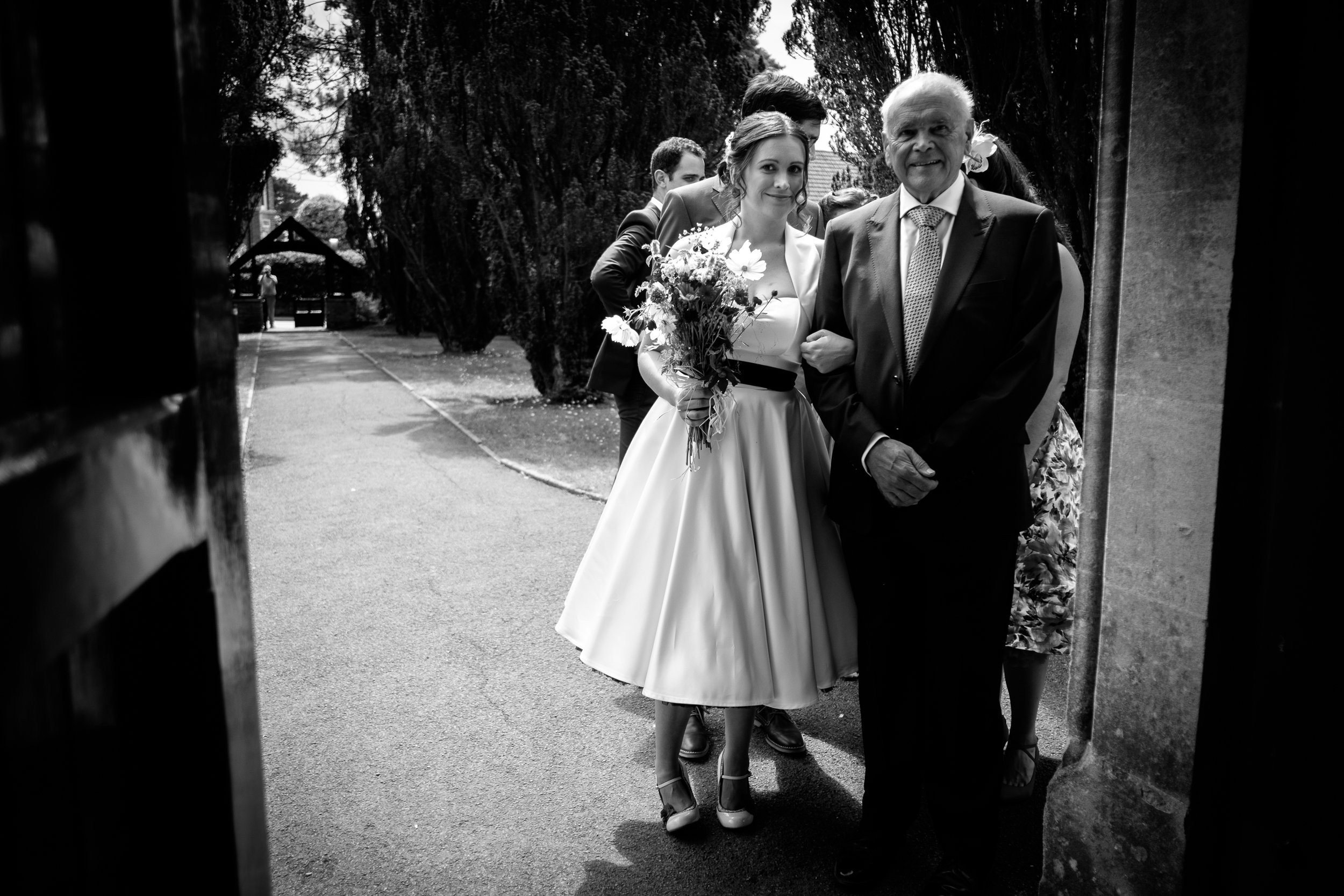 As the nervous bride awaits her entrance with her father.