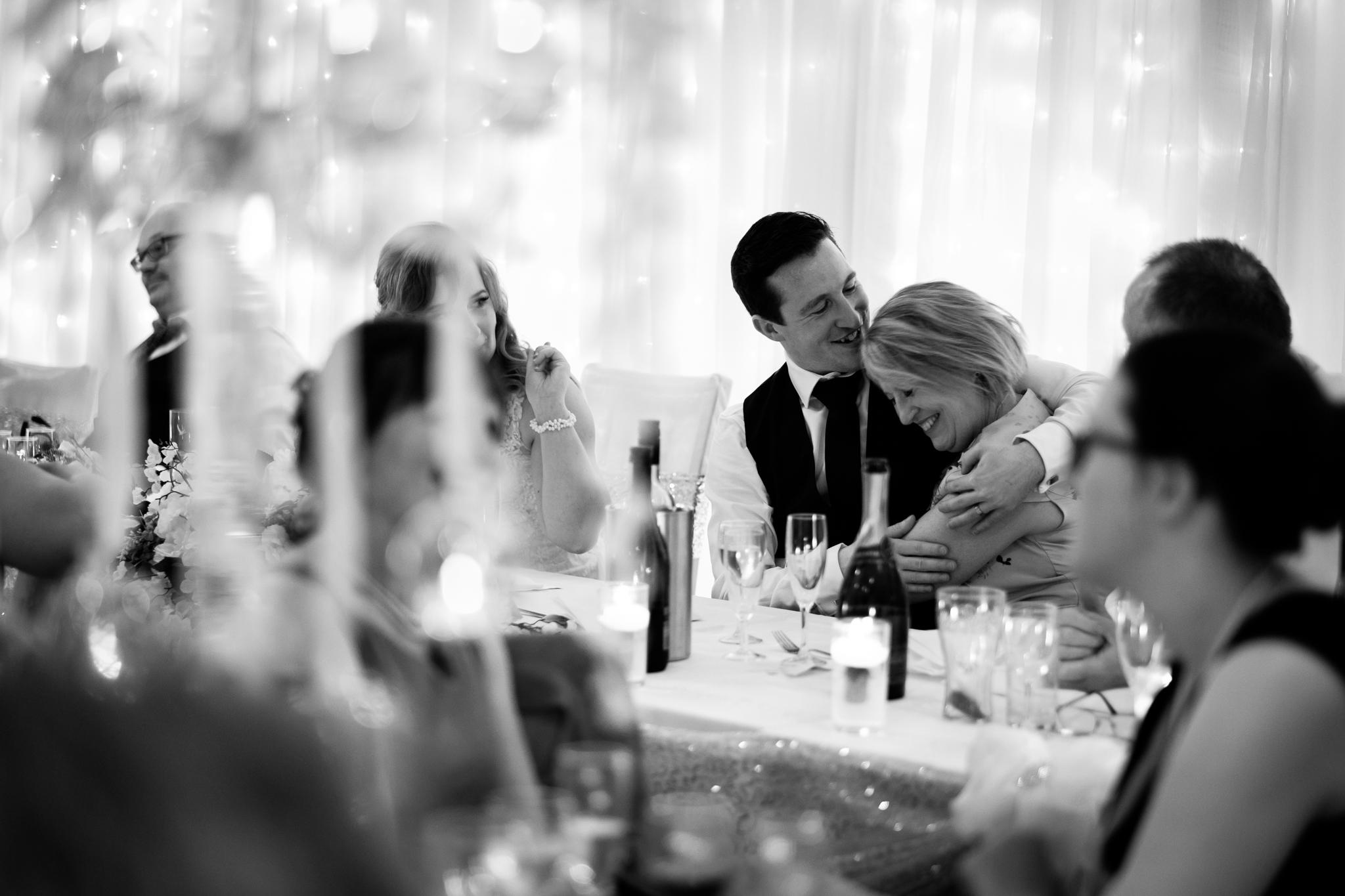 Mother son hug wedding day.jpg