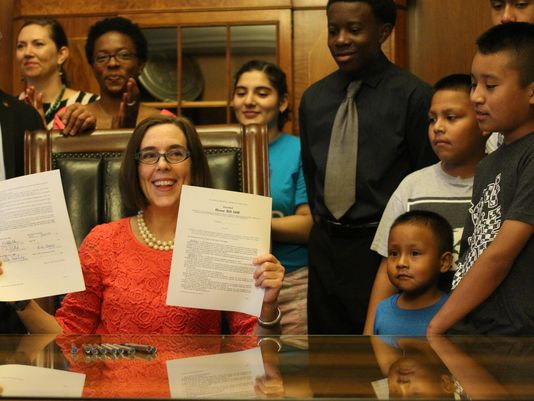 Governor Kate Brown signing into law HB3499 with students and members from communities of color.  (Photo: Gordon Friedman / STATESMAN JOURNAL)