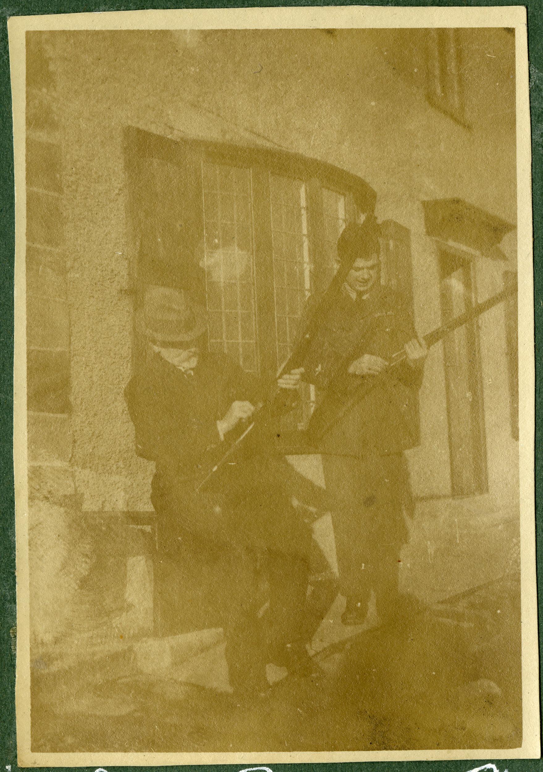 """Cleaning guns before pheasant shoot 1919."""