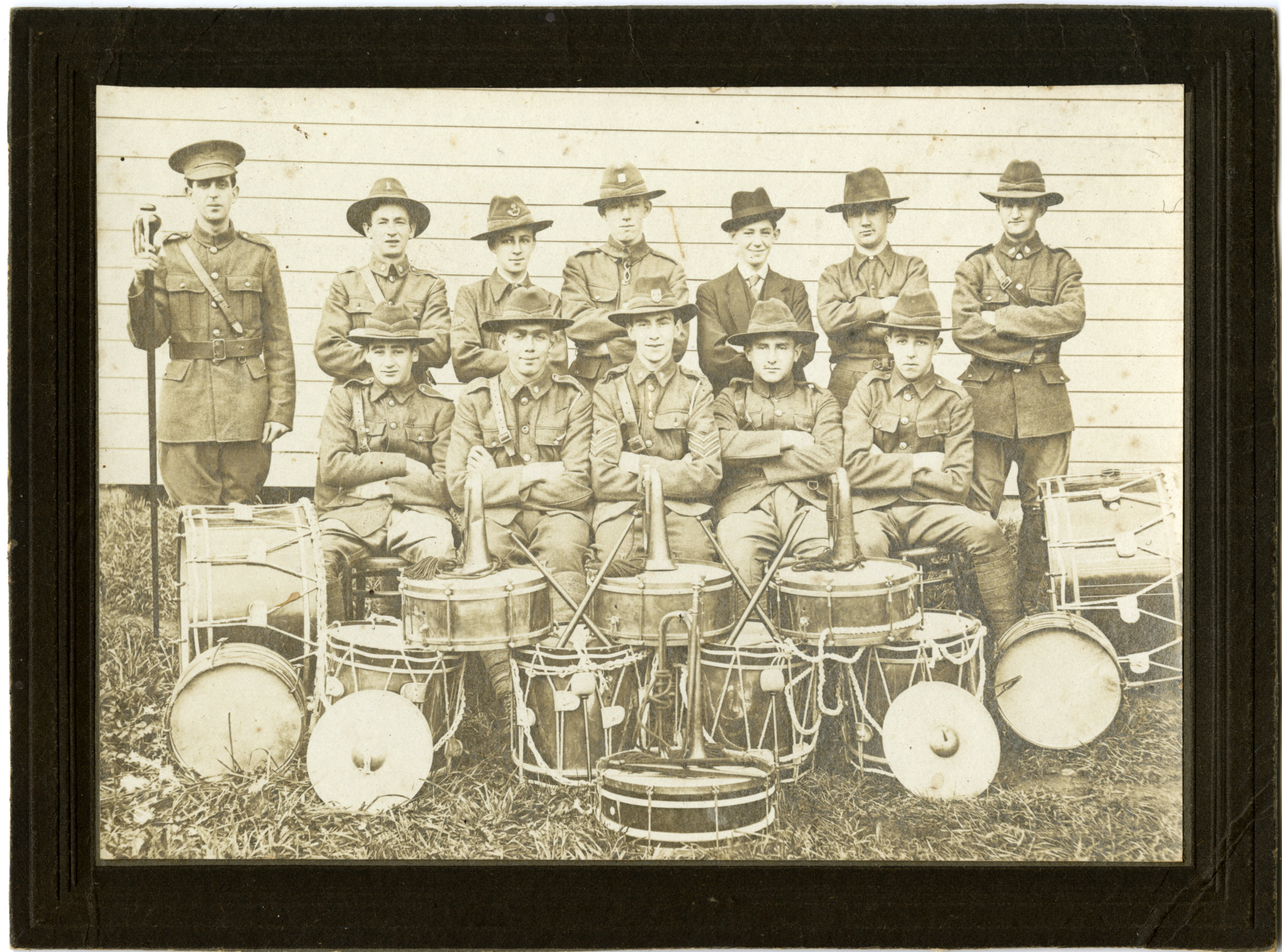 Unidentified military band. Norman is second on left back row, next to man with marching stick.