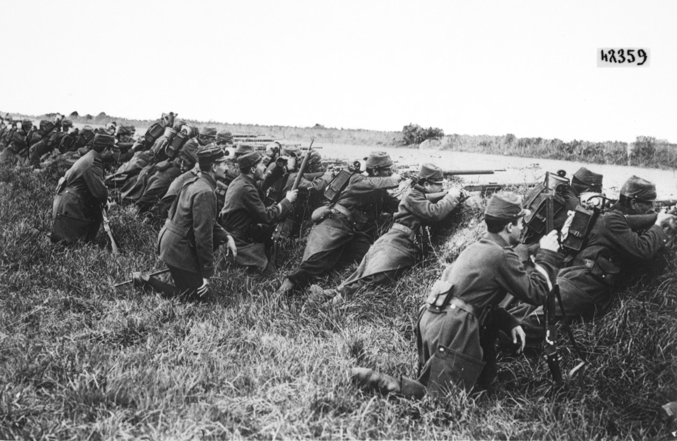 Figure 4: French troops firing from a ditch in 1914, before the front line became entrenched and movement almost impossible. Reference: Bibliothèque nationale de France, Infanterie française en action [tireurs embusqués derrière un fossé]: Photographie de Presse/Agence Rol.