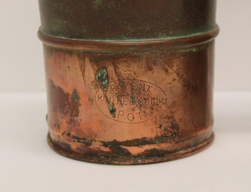 Engraving on base of pot