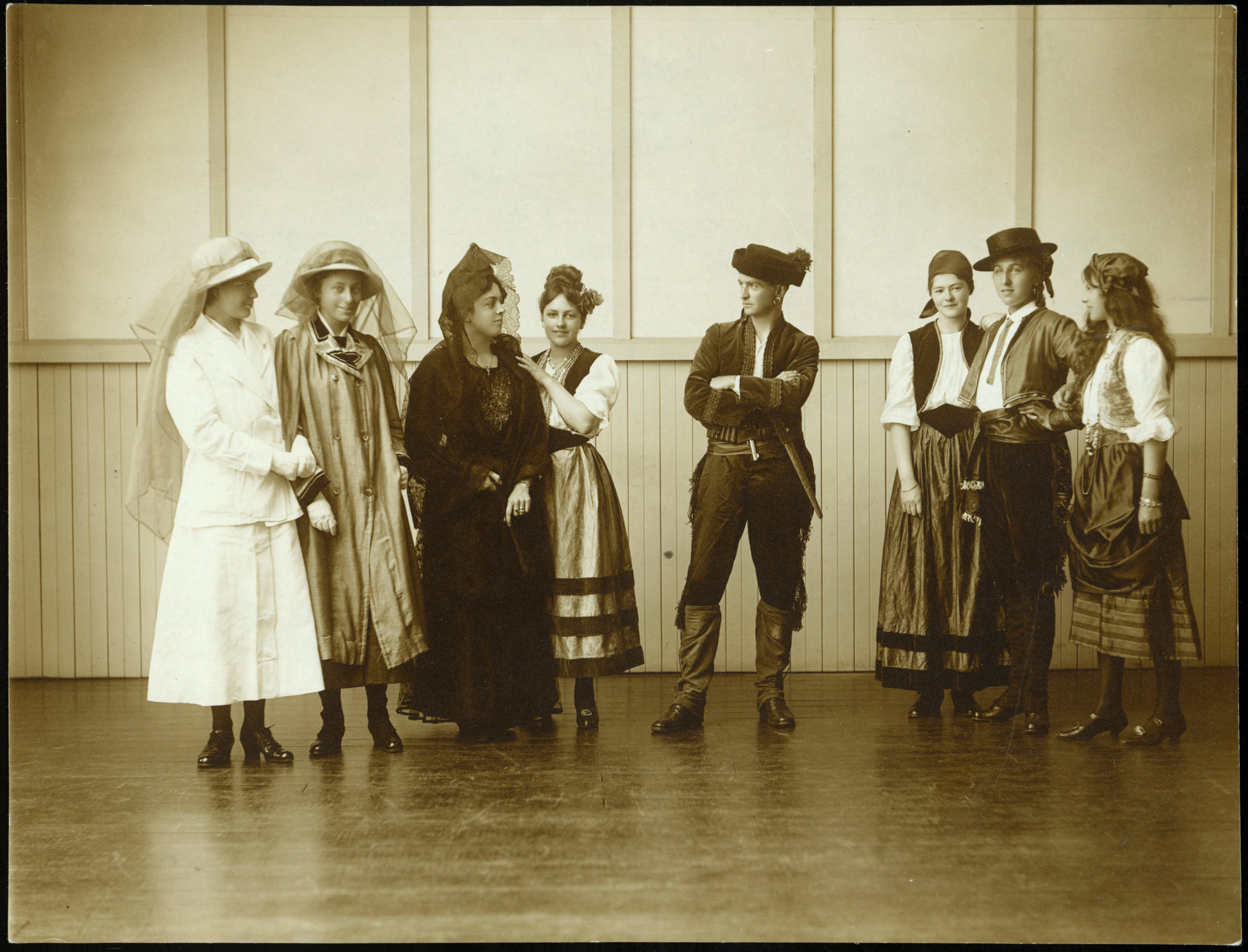 From left: Esther Armstrong, Betty Joske, Nita McHardy, Phyllis Goodson, Mr Stephens (singing instruc[tor]), Jessie Ritchie, Glory Svenson [?], Dorothy Levin. See http://digitallibrary.pncc.govt.nz/ for more historic photographs of Palmerston North schools.