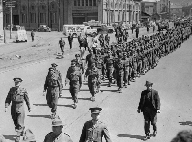 Figure 4: Lieutenant Colonel James Hēnare, followed by Regimental Sergeant Major Charlie Norris, leading his men towards Aotea Quay during a parade in Wellington upon 28th Māori Battalion's return to New Zealand. Source: National Library of New Zealand (unknown photographer), reference # 1/2-C-016251-F.
