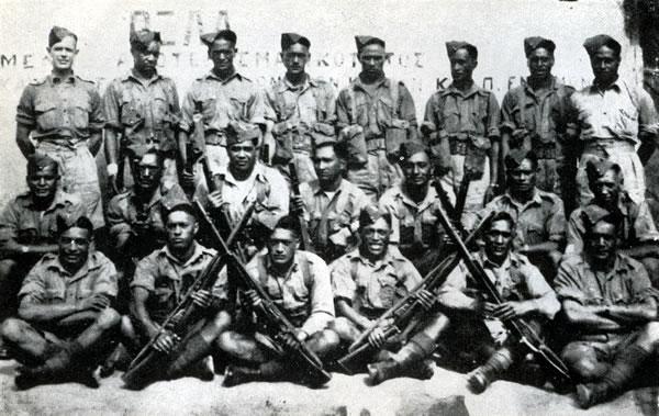 Figure 4: Part of the 28th Māori Battalion Headquarters at Katerini, Greece, in 1941. Matarehua Wikiriwhi, then a Private, is 4th from the left, front row. Source: J F Cody, 28 (Maori) Battalion, Wellington, 1956.