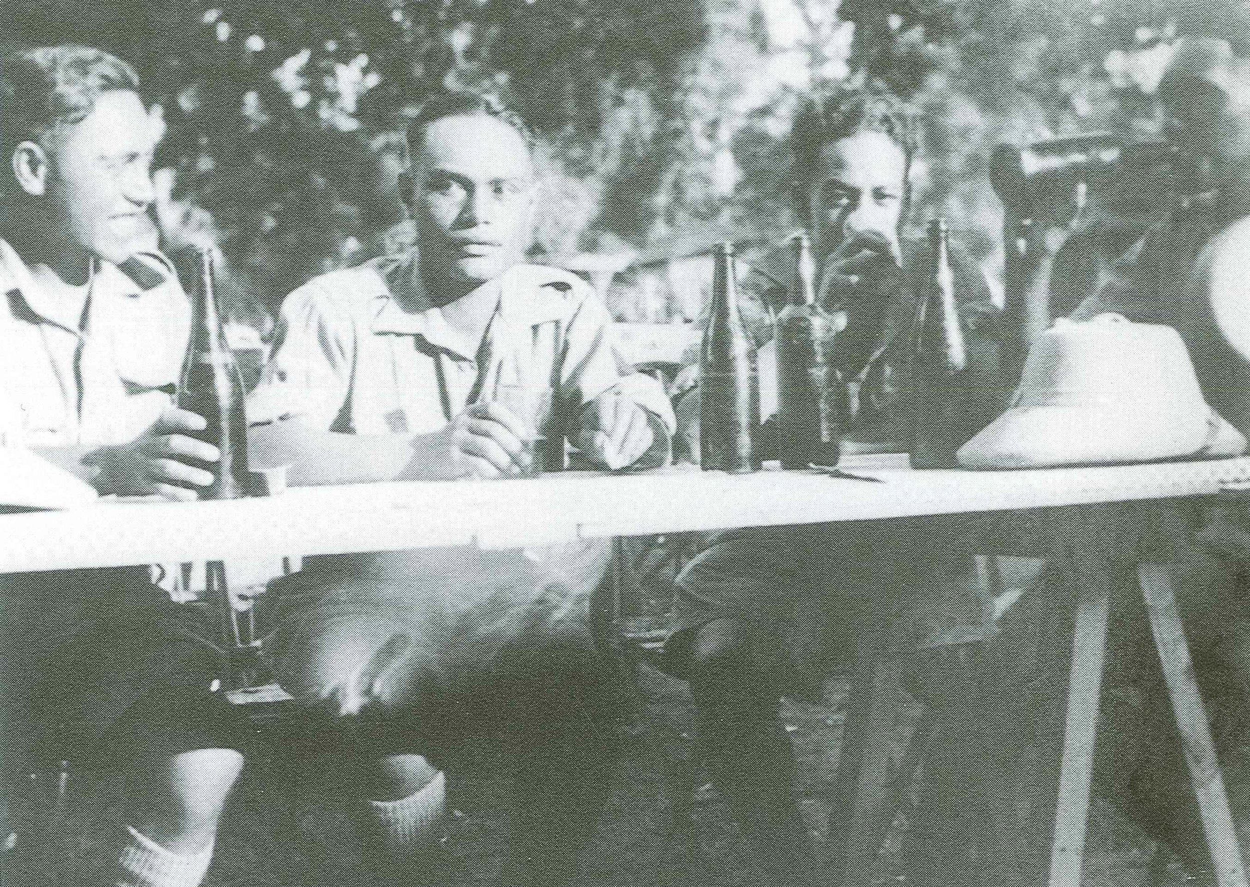 """Figure 5: After they were withdrawn to Egypt, the men of 28th Māori Battalion were given seven days' """"survivors' leave"""". Matarehua Wikiriwhi (far left) enjoys a few beers with Mahuika Waerea, Henry Mathews and Moana Ngarimu. All were part of the intelligence section of Battalion Headquarters. Source: Monty Soutar, Nga Tama Toa – The Price of Citizenship, pg 157."""
