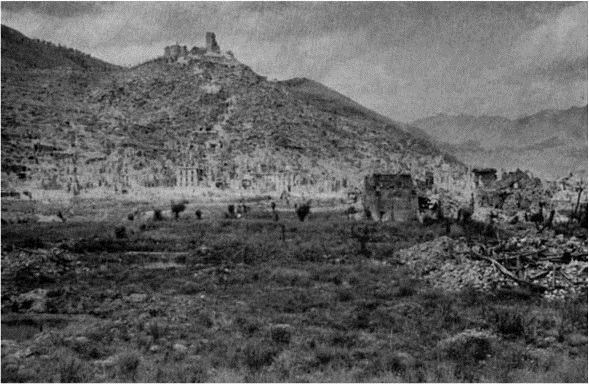 Figure 6: The iconic town and monastery at Cassino, thoroughly bombed out, as seen from the Railway Station across which the 28th Māori Battalion attacked, circa February 1944. Source: J F Cody, 28 (Maori) Battalion, Wellington, 1956.