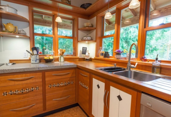 The kitchen features hand-built laminate, teak and maple cabinets, cork floors and concrete countertops.