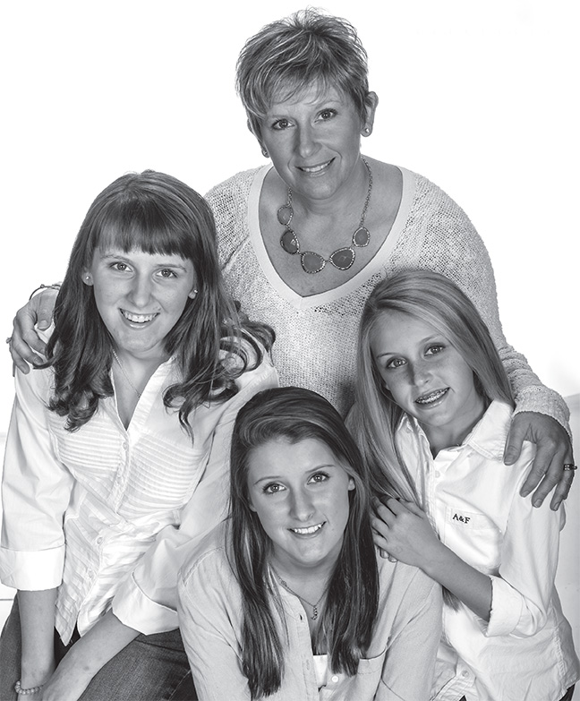 Carla Gregg with daughters Katie, Maddie and Lillie. | Photo by Dixie Knight