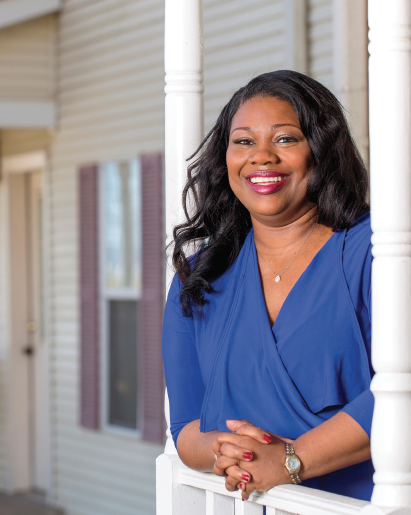Kimberly Lacy stands on the front porch of the Ronald McDonald House in Little Rock.  Photo by Beth Hall.