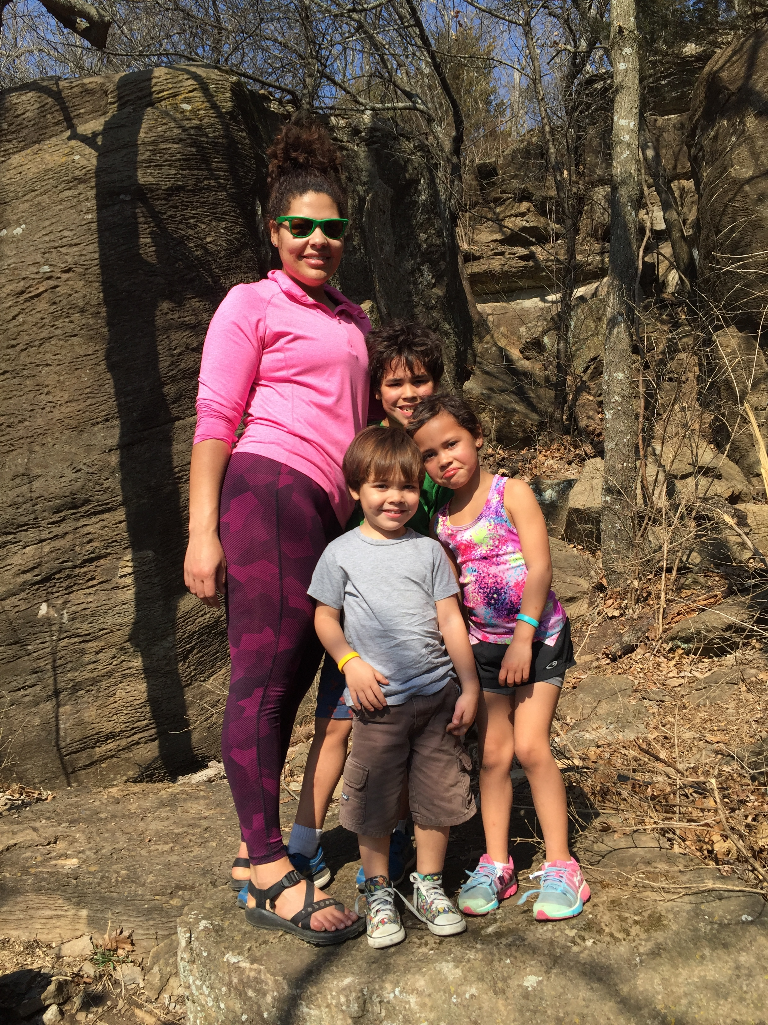 Jasmine Banks, now free from the symptoms of postpartum depression, enjoys a hike with her children Isaiah, Addison and Tobias.