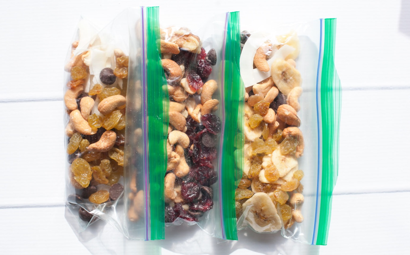 Pack snacks. I typically pack a bag of snacks from our pantry in order to not waste food. We also always bring an ice chest full of waters and milk.