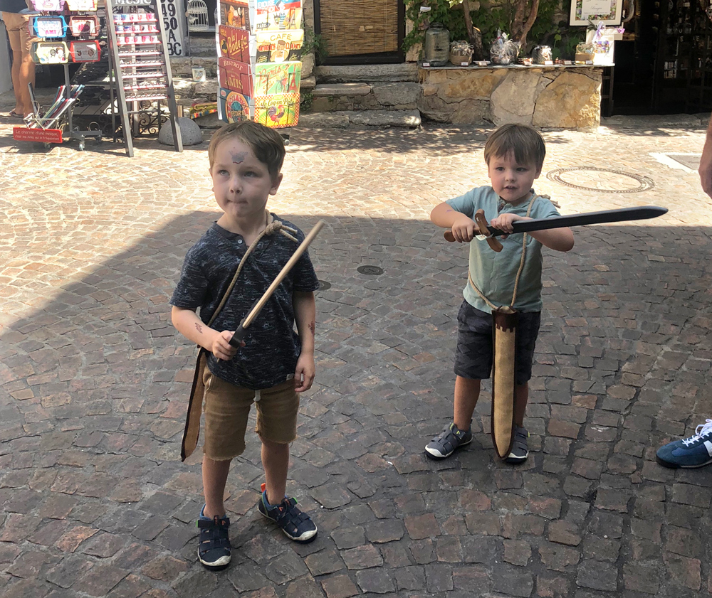 Get the kids enthusiastic about the destination. History, flora and fauna facts are fun and useful. Practicing language basics gave the kids some autonomy—it also connected them to the culture.  They also enjoyed finding swords at a medieval village!