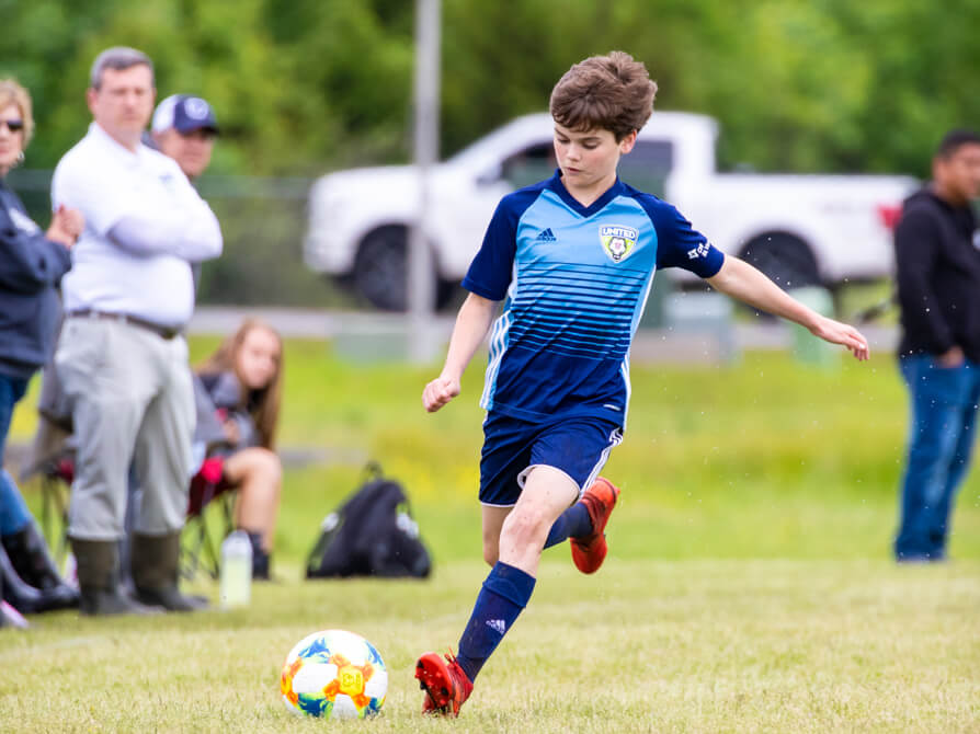 and elliott playing for AR united soccer.