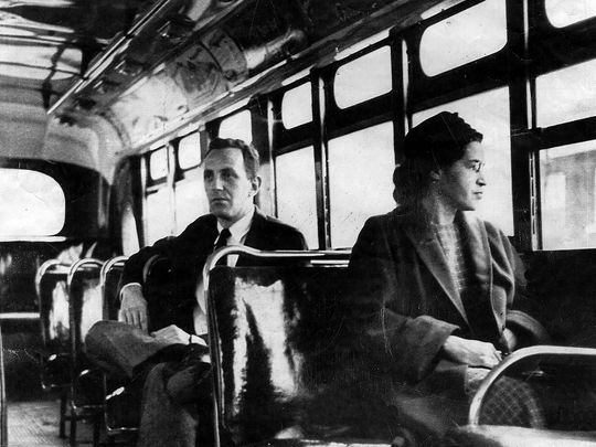 Rosa Parks riding on the Montgomery Area Transit System bus in Montgomery, Ala. Parks refused to give up her seat on a Montgomery bus Dec. 1, 1955, and ignited the boycott that led to a federal court ruling against segregation in public transportation.  (Photo: AP)