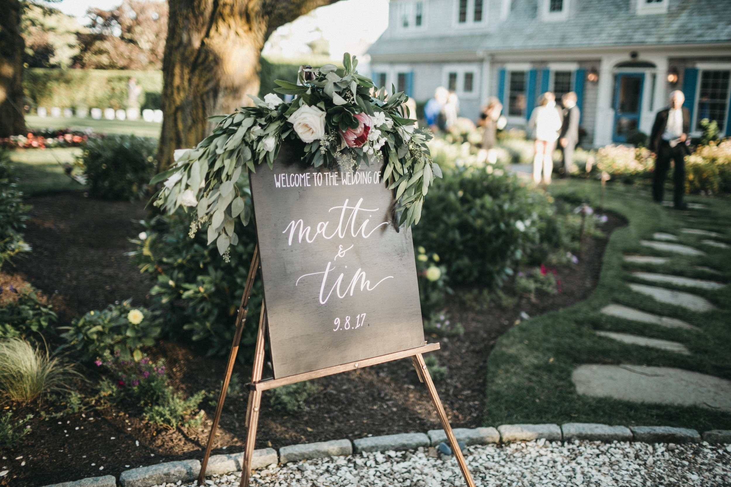wood calligraphy welcome sign