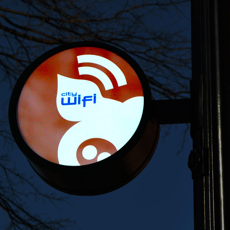 Environmental signage design creatively designates wifi perimeter area.
