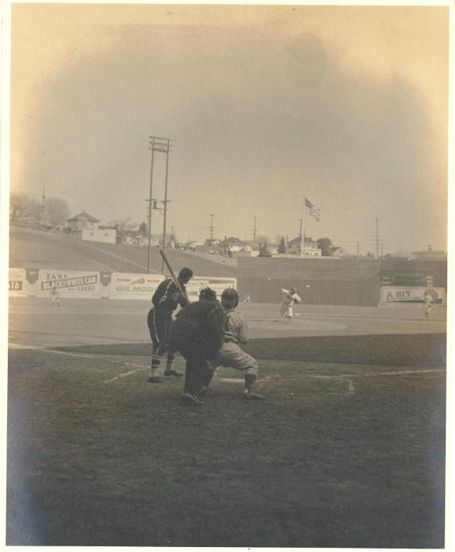 Rainiers Opening Day, 1939, Dick Barrett pitching, Franklin High background – David Eskenazi Collection