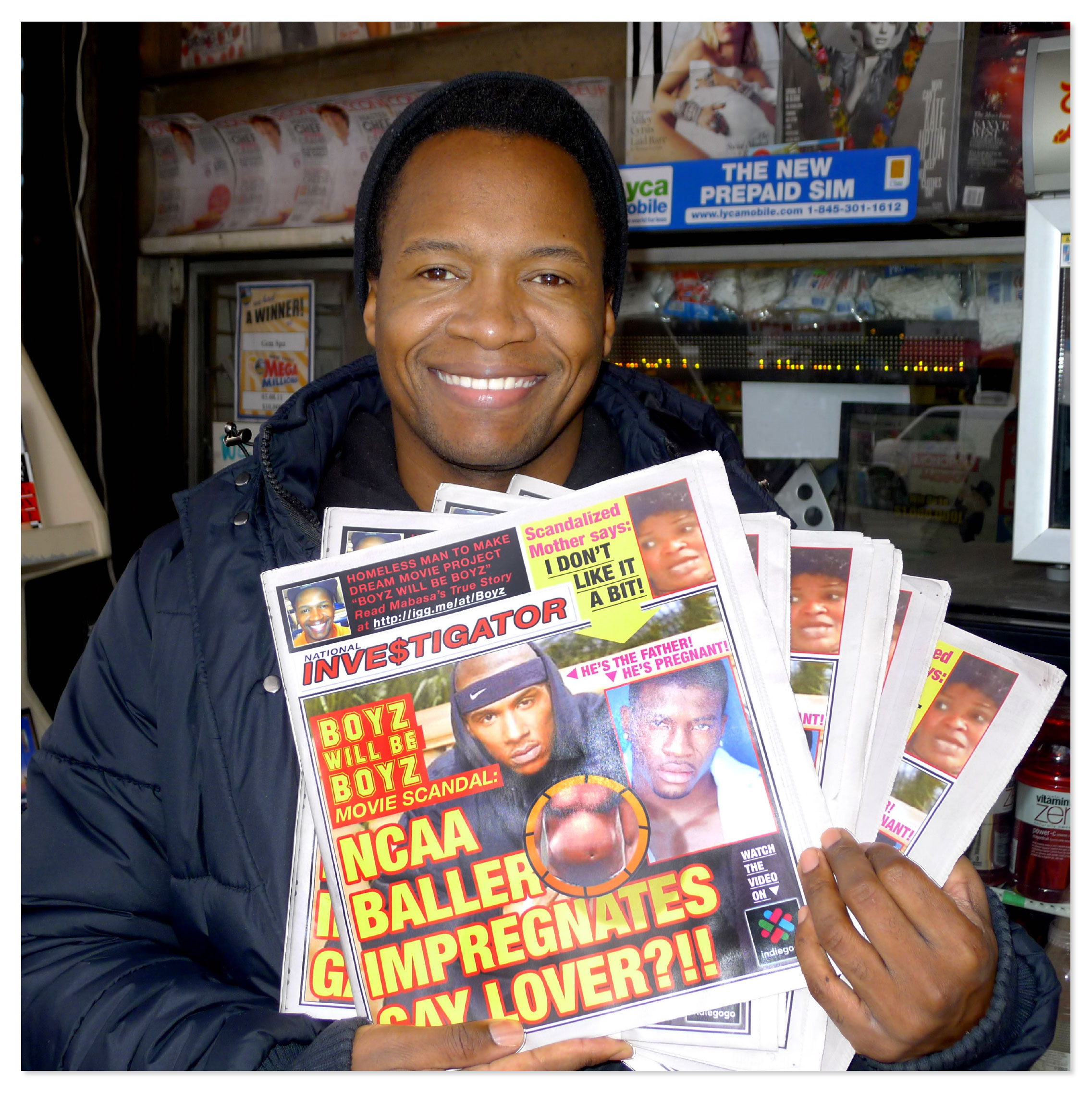 film producer with a stack of the fake tabloid