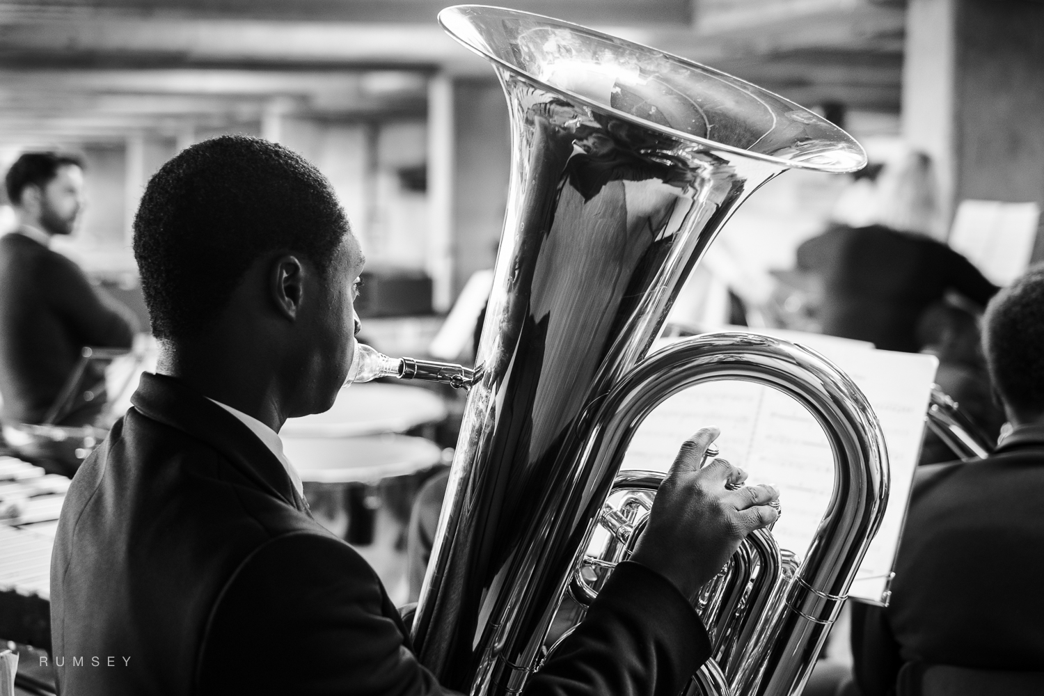 Tuba player with Multi-Story Orchestra