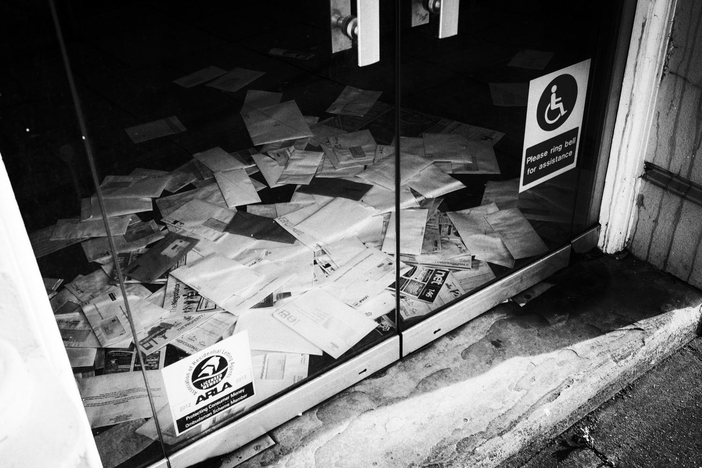 Gone Away: a pile of post on a door mat