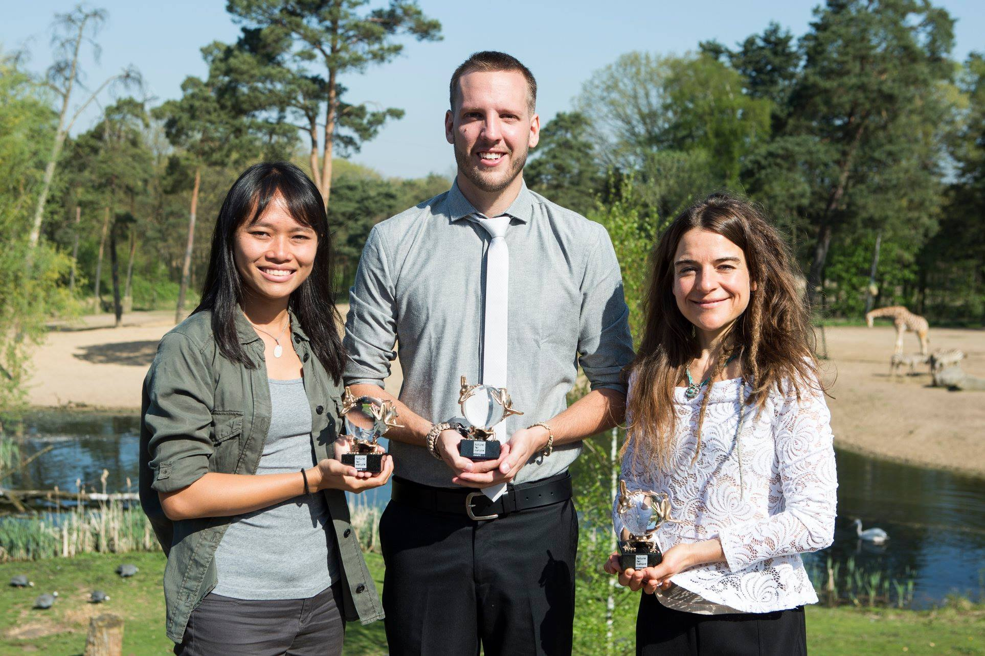 Adam (centre) with his Future for Nature award. Standing alongside him is fellow recipients Trang Nguyen (left) and Geraldine Werhahn (right).