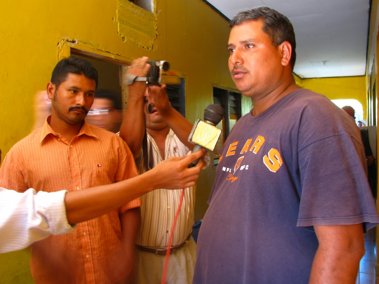 Left to right: two detained campesinos, Osman Alexis Ulloa Flores & Mario Rene Ayala being interviewed by the local press at the police station in Tocoa, Colón, Honduras .
