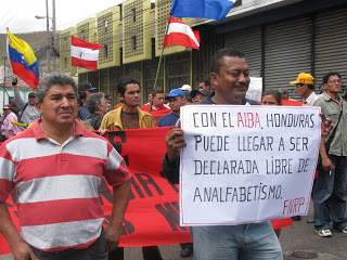 """Signs reads """"Con ALBA, Honduras can become declared a country free of illiteracy"""""""