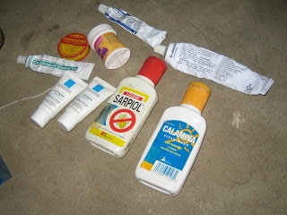 All the medications and creams she has tried to cure the periodic outbreaks of rashes on her son's body.