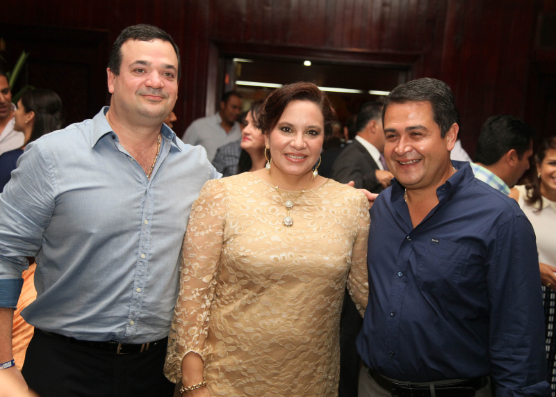 Photo caption: Yankel Rosenthal (left) with Ana Garcia Hernandez and current Honduran President Juan Orlando Hernandez.