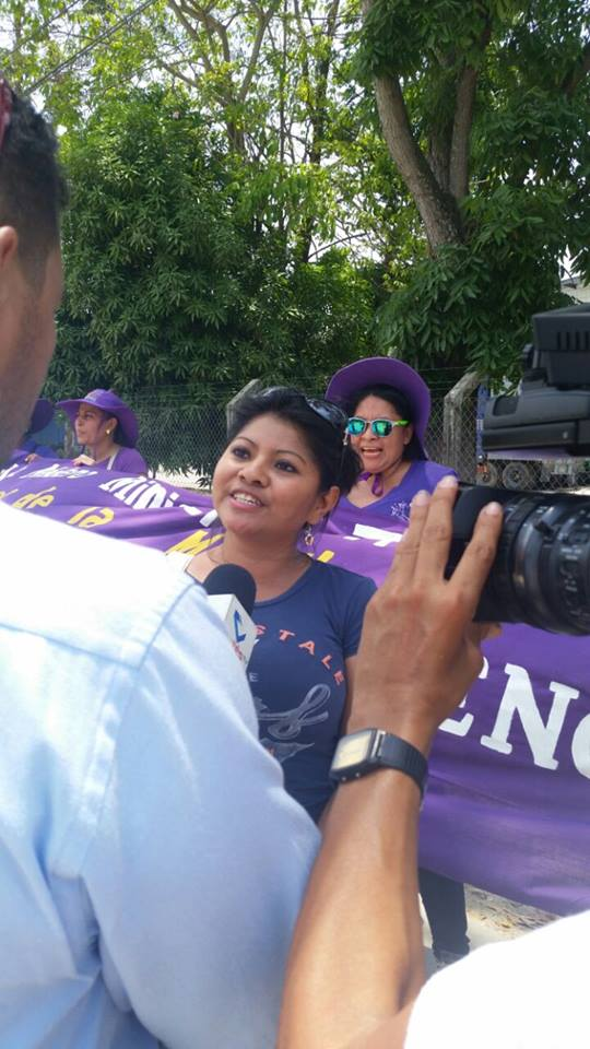 Photo caption: Lilian Castillo giving an interview to local media while protesting outside of Gildan's factory with CODEMUH. Picture by CODEMUH.