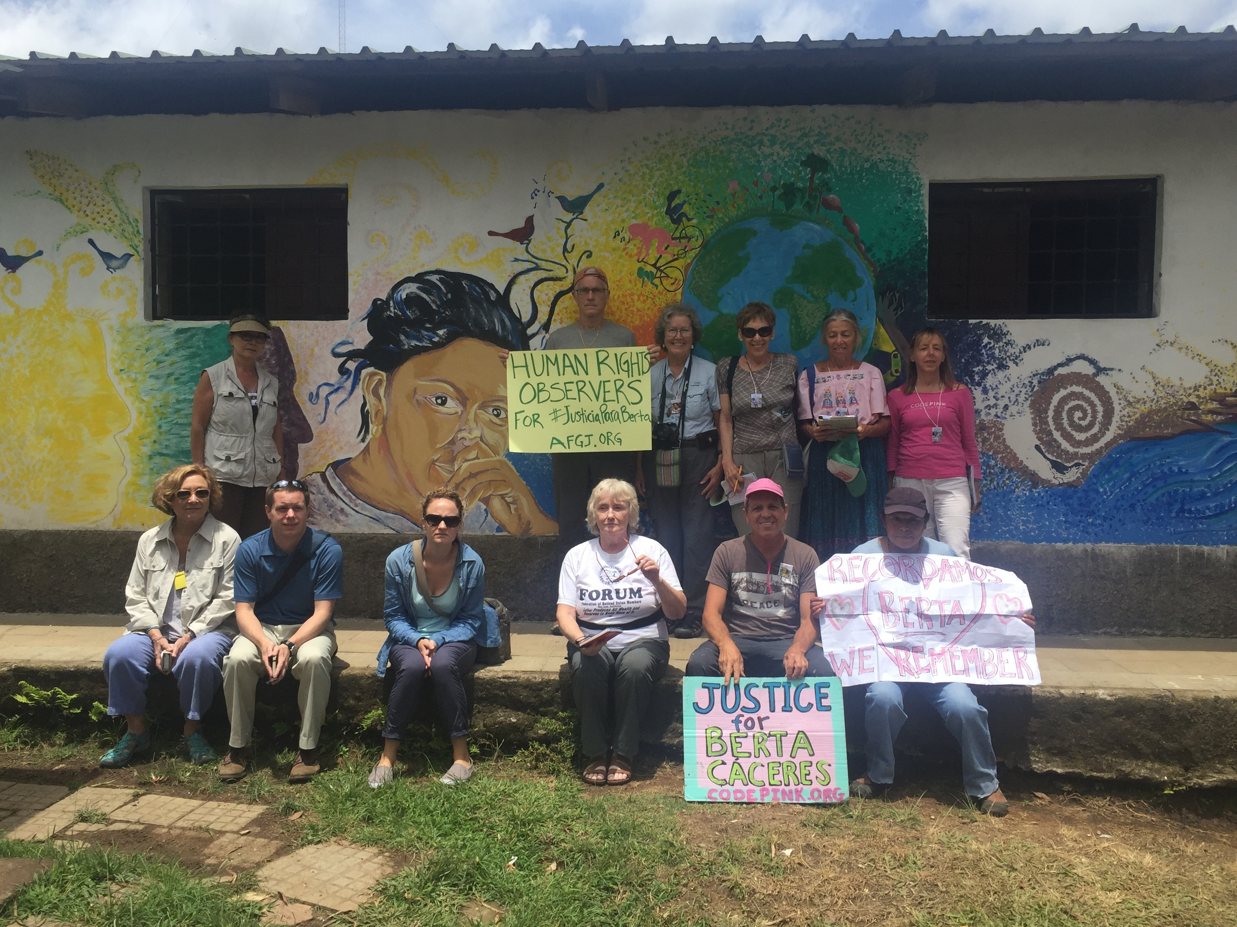 At COPINH's training centre, UTOPIA in La Esperanza. The mural in the back was painted shortly after Berta was killed. We went to various places throughout the day to take pictures and join in the International Twitter campaign organized by Berta's family and COPINH to demand justice for Berta and an International independent Commission of the Inter-American Commission of Human Rights to join the investigation. July 4, 2016.
