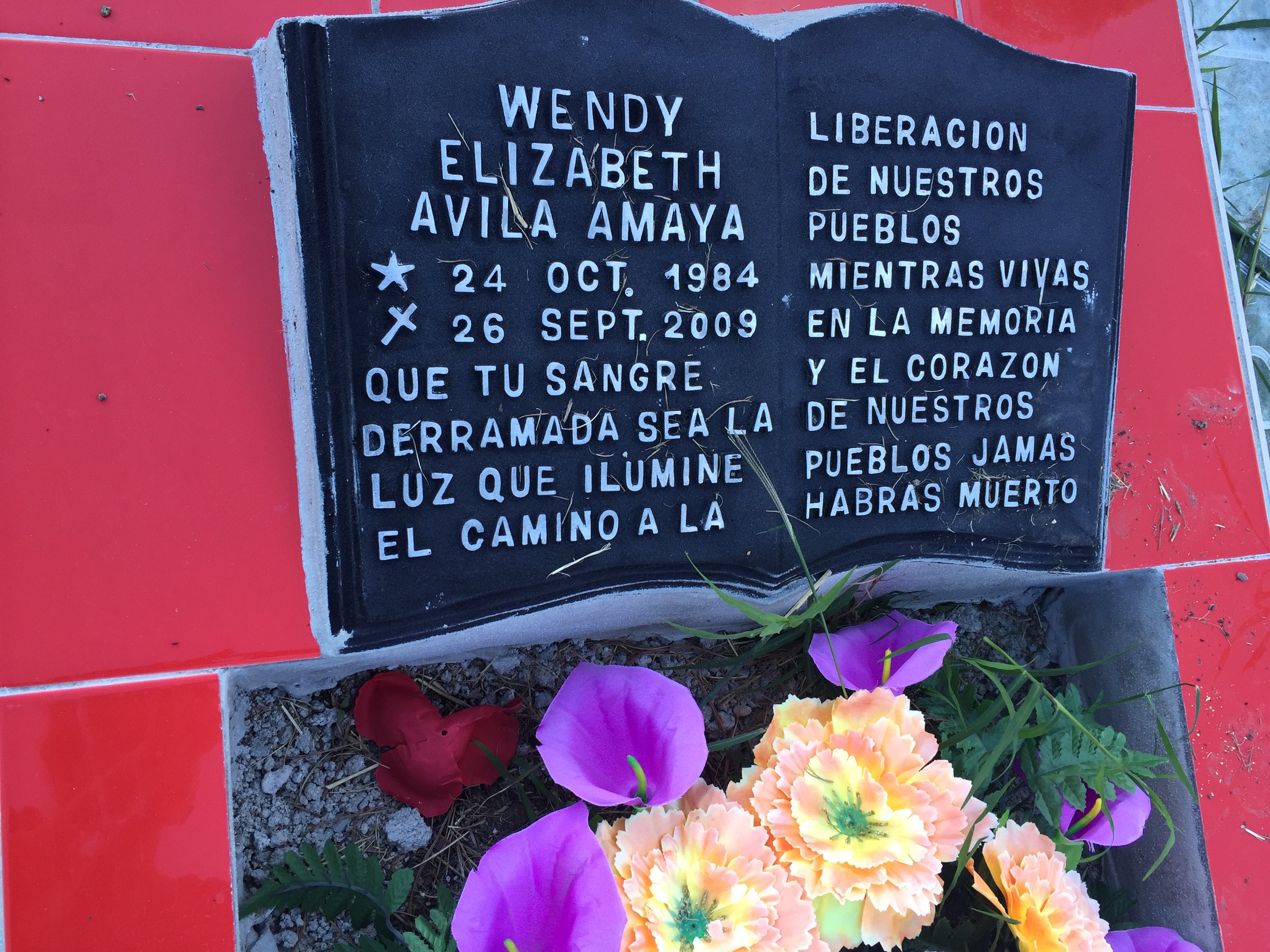 """Wendy's grave stone: """"October 24, 1984 to September 26, 2009. Let your spilled blood be the light that illuminates the path to people's liberation. As long as you live in the minds and hearts of our people, you will never be dead."""""""