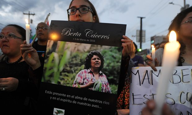 A woman holds a portrait of Berta Cáceres Flores in Tegucigalpa in March. Photograph: Orlando Sierra/AFP/Getty Images
