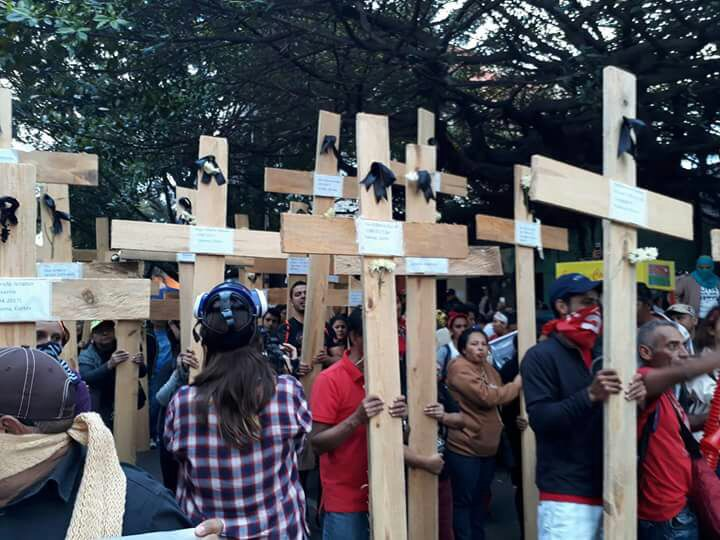 Honduras carry crosses at the event today in front of the headquarters of the Honduran Armed Forces in Tegucigalpa today. Each cross represents people that have been killed by state security forces during the 2017 electoral crisis and fraud. Picture by Edgardo Soriano.