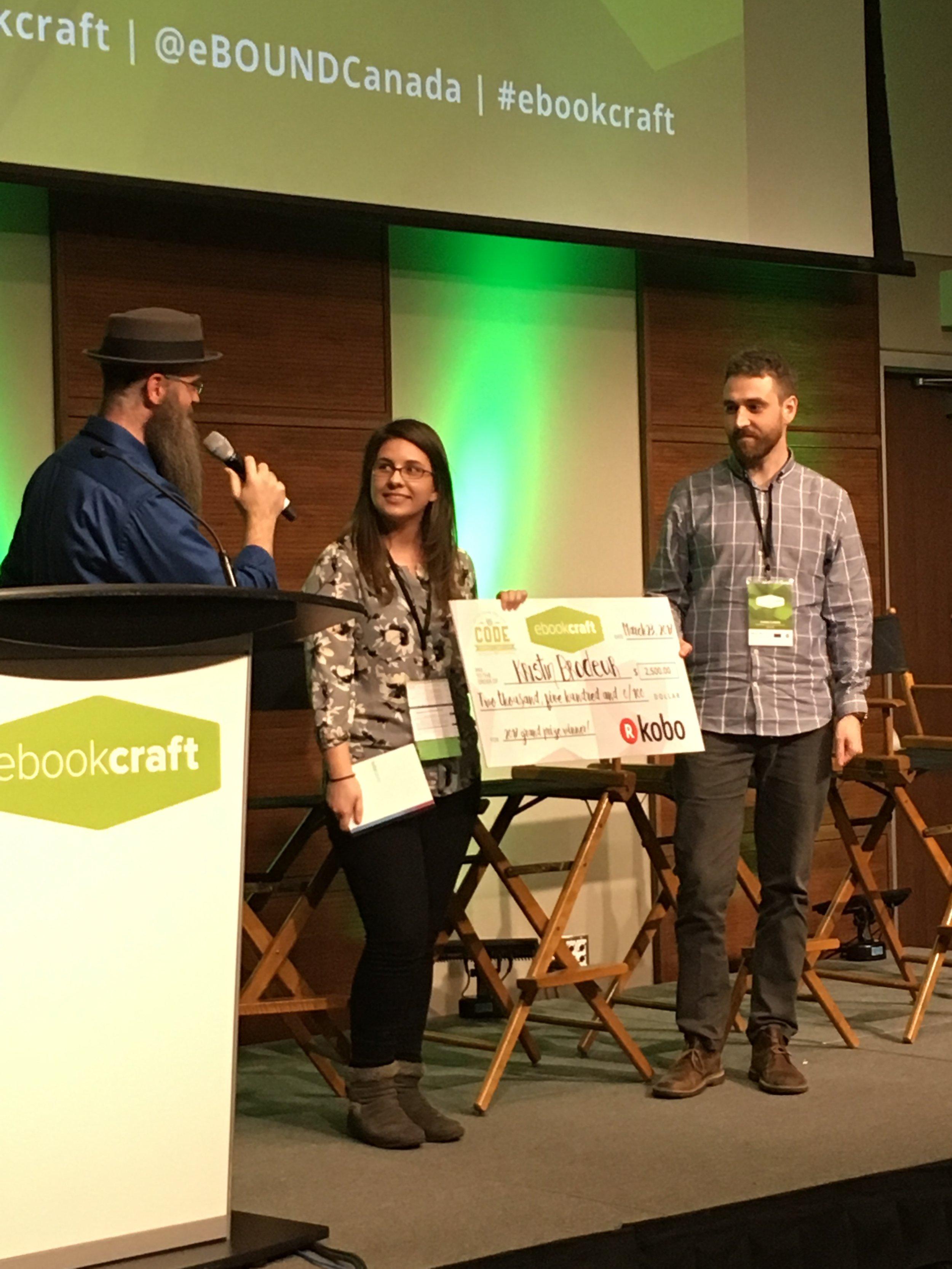 (L-R: Joshua Tallent, judge, Kristin Brodeur, winner, and Symon Flaming, Kobo representative.)
