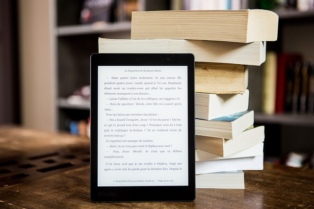 A stack of books and an iPad in front of them.