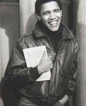 Photo of a young Barack Obama holding a book.