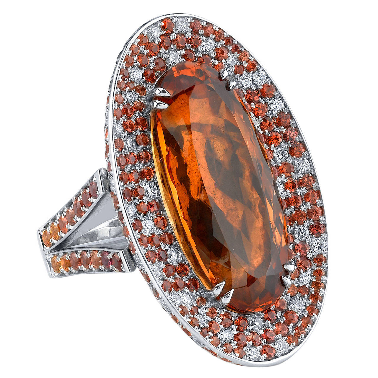 21.99CT Precious Imperial Topaz set in 18 Karat White Gold, accented with White Diamonds and Orange Sapphires.
