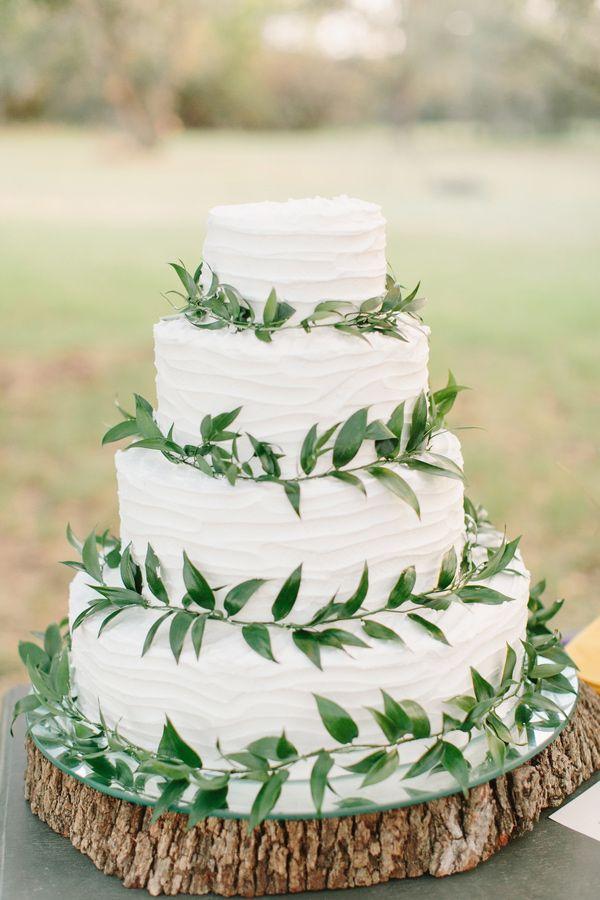 White wedding cake with greenery